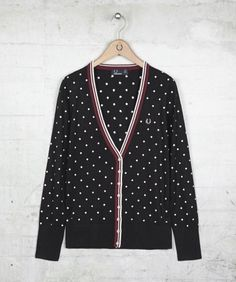 Soft knitted cardigan crafted in a soft rayon blend fabric, complemented by all over embroidered diamonds and fine tipping down the placket. Complemented with ribbing to the hem and cuffs and a deep V neck design; this button through style sits perfectly