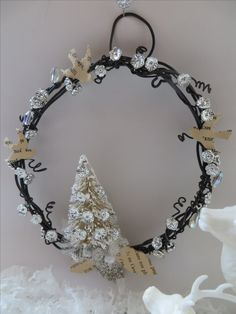 Small whimsical winter wreath with old book paper,  bottle brush tree, old silver plastc flowers, Czech crystals
