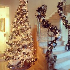 """Christmas tree & garland. Silver, gold & white gold, white & clear ornaments with a touch if """"bling""""!"""