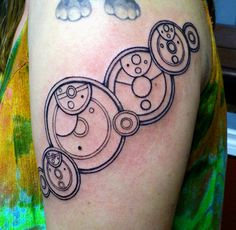 """Just in time for the 50th, I got my Gallifreyan tattoo last night.  """"People assume that time is a strict progression of cause to effect but actually, from a non-linear, non-subjective viewpoint, it's more like a big ball of wibbly-wobbly, timey-whimey…stuff."""" (it's just the wibbly-wobbly, timey-whimey part)"""