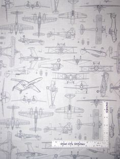 """Collection / Print #: Aviator Collection / #24755-E Airplane Drawings Gray. This fabric does not meet the standard for the flammability of children sleepwear. Made by: Quilting Treasures Fabric. This fabric is: 44"""" wide, 100% cotton, new and right off the bolt. 