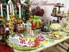 Iced sugar cookies, jar candle, present cake, plum pudding, checkerboard cake, Christmas tree candies, snowflake cookies and candy canes by Crown Jewel Miniatures