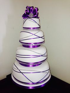Purple, diamanté wedding cake by thecakecrumb.