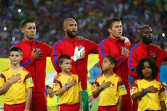 (L-R) Clint Dempsey, Tim Howard, Matt Besler and DaMarcus Beasley of the United States look on during the National Anthem during the 2014 FIFA World Cup Brazil Group G match between Ghana and the United States at Estadio das Dunas on June 16, 2014 in Natal, Brazil. (Photo by Kevin C. Cox/Getty Images)