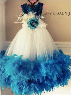 Bright and Bold and full of fun, who wouldnt want to wear this gorgeous satin and tulle feather dress!    A girl just cant help but feel like a