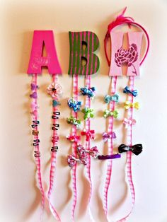 "When I was pregnant with my daughter, I had no idea the amount of bows and clippies that were in my future!  Korkers and hearts, barrettes and alligator clips… getting left on the changing table, bathroom vanity, and kitchen counter.  I needed a quick solution to the proliferation of ""pretties.""  This simple Bow-Holding …"