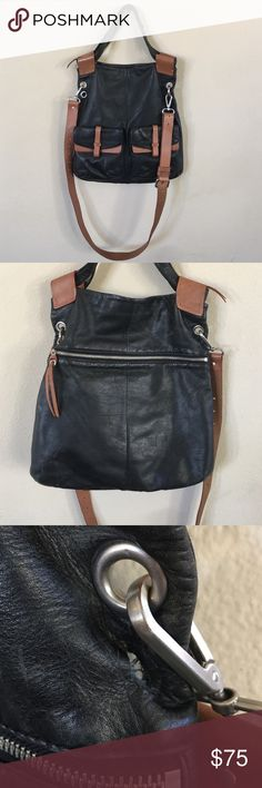 Christopher Kon Foldover Crossbody Two ways to tote this Christopher Kon bag: Enjoy the space of a tall, top handle bag or keep your hands free and fold the top over to carry as a crossbody. As pictured some pilling on the inside but no stains. Missing 1 metal grommet from back.  * Color is cognac and black * Brushed nickel hardware. * Flat shoulder straps; removable, adjustable crossbody strap. * Fold-over zip top . * Outside, two buckle-flap pockets on front. * Inside, two zip and two open…