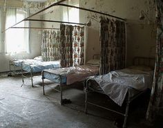 Leftover beds in abandoned mental asylum - Cane Hill in Croydon district of London