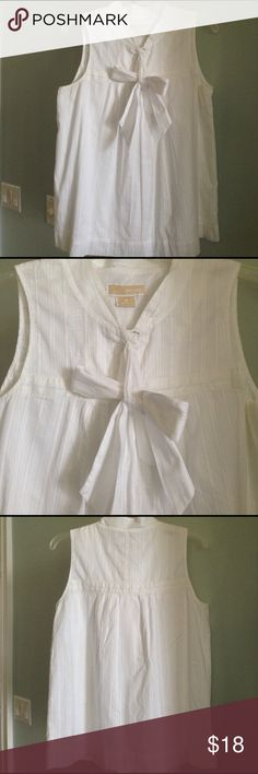 """MICHAEL MICHAEL KORS Sleeveless Top With Tie Details  - White Eyelet Sleeveless with Front Tie - Two Buttons and one Snap  - Fully Lined - Size 8 (Size S-M) -  Approx. 25.5"""" from Top to Bottom of Hem, 19"""" Pit to Pit - In Excellent Condition  Fiber Content: 100% Cotton MICHAEL Michael Kors Tops Blouses"""