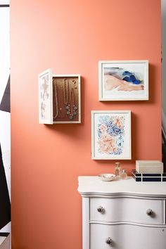 """Keep jewelry from junking up your dresser by concealing pieces in Lawrence Frames Shadow Box ($35.99 for 11"""" x 14""""; Amazon.com). Mount artwork or a photo behind glass, push small flathead nails into the canvas backing and use to hold jewelry"""
