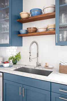 Buying a new sink allows you to customize the number of holes to fit your preferred faucet. #easyweekendprojects #homeremodelprojects #homeimprovement #weekendprojects #bhg Blue Kitchen Countertops, Blue Kitchen Cabinets, Glass Countertops, Bathroom Countertops, Kitchen Tiles, Blue Kitchen Ideas, Kitchen Black, Kitchen Appliances, Kitchen Modern