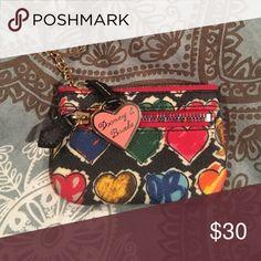Dooney & Bourke multi heart mini Dooney & Bourke multi heart mini change wallet. Barely used. Dooney & Bourke Bags Wallets