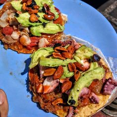 """Sea urchin and clam / Octopus and bacalao (salted cod) tostadas with avocado and roasted chili peanut salsa. A trip to #Ensenada is simply not complete without a visit to Mariscos """"La guerrerense"""" street cart.  Tostada-adventure by @clubdegourmands  #seafood #seaurchin #clam #Octopus #bacalao #tostada #tasty #baja #Mexico #food #Ensenada"""