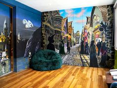 Fabulous comfy beanbag sits invitingly before equally fab mural on doors & fitted cupboards #harrypotter #bedroom