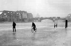 isn't every day one has the chance of riding along or over the River Thames. But that chance came to cyclist David Joel as he took to the frozen river near Windsor Bridge. At Windsor the Thames is frozen from bank-to-bank for a considerable distance. London Pictures, Old Pictures, Old Photos, London Photos, Vintage Photos, London History, British History, Local History, History Pics