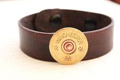 Authentic shotgun shell on hand dyed leather cuff by woobiebeans on Etsy https://www.etsy.com/listing/109158248/authentic-shotgun-shell-on-hand-dyed