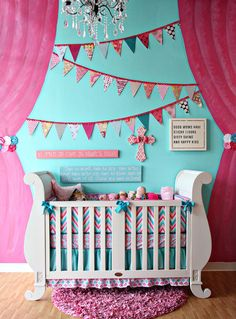 "Great Idea! PAINT ""curtains"" on the wall of the nursery. You could totally do this in a little girl's bedroom as or playroom as well!"