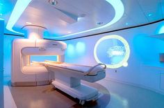 "The bright lighting is futuristic and certainly ""high tech"" looking at this MRI scan room location."