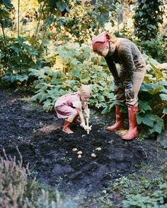 Mother and daughter working with the earth.