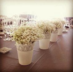 Simple aisle flowers or table decor using Ikea decorative pots with gypsophila.