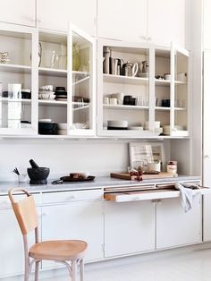 A boon for any kitchen, large or small: a pullout cutting board. Kitchen cabinet specialists Wood-Mode make a range of built-in storage designs, including a Pullout Chopping Block. Photograph via J. Ingerstedt.