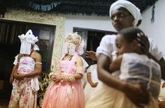 Worshippers, some dressed as female deities, gather for a Candomble ceremony honouring the goddesses Iemanja and Oxum in Itaborai, Brazil. Candomble is an Afro-Brazilian religion whose practitioners can fall into trances during ceremonies believing they have become possessed by gods, or orixas