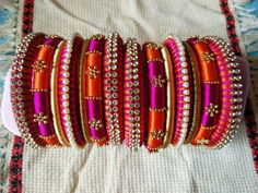 A South Indian bride's pride is her gorgeous Kanchipuram sarees which are further complimented by the colourful, matching bangles. The traditional sarees and bangles combo enhance and accentuate he. Silk Thread Bangles Design, Silk Thread Necklace, Silk Bangles, Beaded Necklace Patterns, Bridal Bangles, Thread Jewellery, Jewelry Patterns, Diy Jewellery, Fabric Jewelry