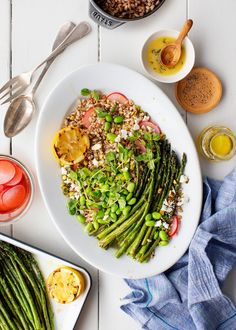 Grilled asparagus is so delicious! Serve this tangy, deliciously healthy farro salad at your BBQ gatherings - a great Memorial Day weekend side dish recipe.