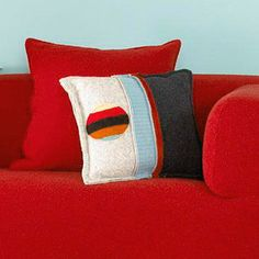 Felted Throw Pillow-Repurpose your worn wool sweaters as pillows! Once you machine-wash wool, the fabric no longer ravels and you can use it to stitch home accents, such as these pillows