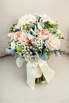 A shabby chic wedding doesn't always mean your colour way should stay neutral. By including subtle hints of colour in your bouquets and centre pieces you can add a bit of fun and excitement.
