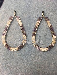 Brick stitch hoop earrings. By Sam Finkbonner