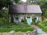 The Gardener's Cottage, near Glenveagh Castle in County Donegal, Ireland; photo by Flickr user positivelypurple.