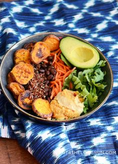 """grain bowl """"Buddha bowl"""" recipe idea  Warm  1 small sweet potato (roasted for 45 mins at 400F w/ coconut oil and garlic salt) 1/3 C of cooked quinoa (how to cook quinoa) 1/4 C of black beans 1/2 C of shredded carrots Cold  1/2 C of Arugala 1/2 small avocado Dressing  I used garlic hummus, but I've used tahini sauce in the past I also added a touch of seasame oil & garlic mustard"""
