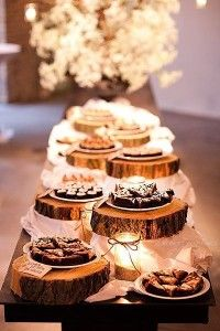 Place the wedding reception food or desserts on cut out pieces of wood to add that rustic or country theme