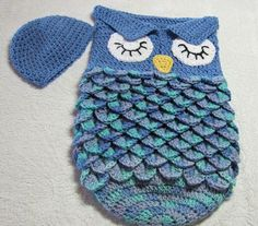 Blue owl baby cocoon and beanie with crocodile stitch sack. This measures 11-12 across when laid flat and is 18 long. The beanie is plain blue .