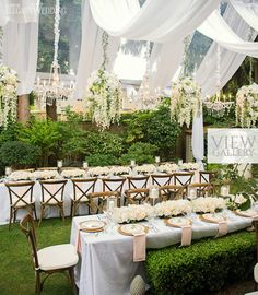 ELEGANT TENTED WEDDING WITH FLORAL CHANDELIERS