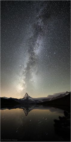 The Milky Way rises above the Matterhorn in the Swiss Alps.
