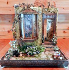 Garden Shop  of statues, cats, plants, flowers, gardening supplies, gnomes, bird feeders, dutch door,copper roof,faux stain glass.