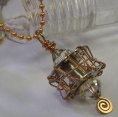 Altered sewing machine bobbin pendant - what an idea :-)