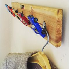 coat rack, hook, toys, upcycled Hang on! I know what you're thinking, coat hooks aren't exactly cool. Well, who says they can't be? I decided to carry the spirit of my childhood into maturity by making this playful coat rack from a bunch of old Hotwheels toy cars.