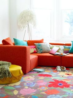 Fascinating Bright Sofa with Surprising Color Combinations : Bright Living Room Orange Bright Sofa Floral Carpet Motive