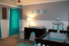 Landon's Room. Simple turquoise blue & green, grey and white colors with a chevron theme. Stars for Mom and colors for Dad. #babystufffordad