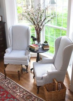 Navy Blue Ticking Stripe fabric used to create custom slipcovers for these outdated Ethan Allen Wingback Chairs.