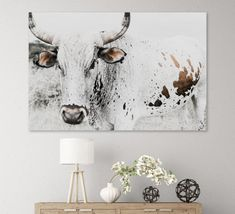 Since childhood, Animals have always been a big part of my life, and there is just something magical about Nguni that has intrigued me over the years and this has sparked my journey to photograph these images for 'The Sacred Herd series.  Own a piece of South Africa and join the herd