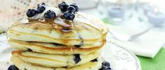 Better Blueberry Pancakes | The Biggest Loser 1/2 cup reduced-fat buttermilk 1/2 cup whole-grain oat flour 1 large egg white, lightly beaten 1/2 teaspoon baking soda 1/4 teaspoon vanilla extract 1/4 teaspoon salt I Can't Believe It's Not Butter! spray 1/2 cup fresh or frozen (not thawed) blueberries Sugar-free, low-calorie pancake syrup (optional) 100% fruit orange marmalade spread