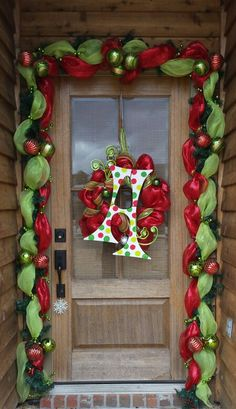 Best 11 Next time you're at Hobby Lobby, grab some cheap mesh and copy this Christmas idea! Whoville Christmas, Front Door Christmas Decorations, Christmas Front Doors, Whimsical Christmas, Christmas Porch, Christmas Centerpieces, Outdoor Christmas, Christmas Themes, Christmas Wreaths