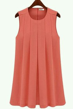 A lovely pleated top, sleeveless, and in the #trending color of corals, almost long enough for tunic.