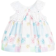 Baby girls pastel coloured sleeveless dress byBalloon Chic. Made in soft woven cotton and featuring an all over colourful floral print with broderie anglaise trims. With all round gathering, the dress is full and flared and fastens at the back with a concealed zip. It comes with a pair of white cotton knickers which a large bow at the back.