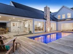 Hamptons-Style House Design - Storybook Designer Homes Decking around pool Hamptons Style Homes, The Hamptons, Hamptons Kitchen, Melbourne, Custom Home Designs, Patio, Backyard, Beach House Decor, Beach Houses