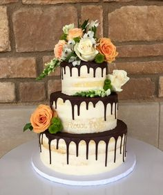 beautiful semi naked wedding cake with fresh flowers and a chocolate drip @flourshoptx